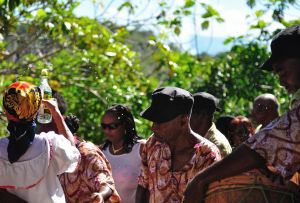 8d. JB overproof white rum is sprayed on the Maroon performers as well as on the public sitting under the Kindah Tree. The rum is said to ward off spirits and bring forth good luck for the year.