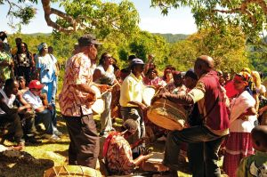 8a. There is drumming and chanting for an hour under the Kindah Tree. The men beat the drums while the women chant.