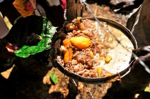 10b. Unseasoned, unsaltened pork with yams and horse plantain, served in bits to the crowd on a leaf.