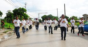 Marching bands walk through town on Saturday afternoon to promote the annual town fiesta that weekend.