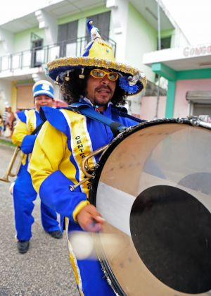 The lively costumes and the sounds of drums get the town geared up for the evening fun ahead.