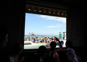 Starting Thursday afternoon, people from all over descend on San Pedro for the festival. The girls decide to greet them from their lunch table at Tackle Box, next to the water taxi stop.