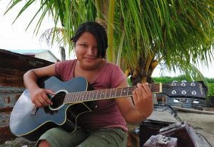 Ocean Academy student Lily loves to play the guitar| Copyright Lebawit L. Girma