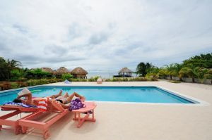 A couple relaxing at the nearby St. George's Caye Resort