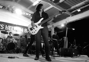 "Female bass player Dina Halsall, member of Belizean Rock band ""Ascenthium"""